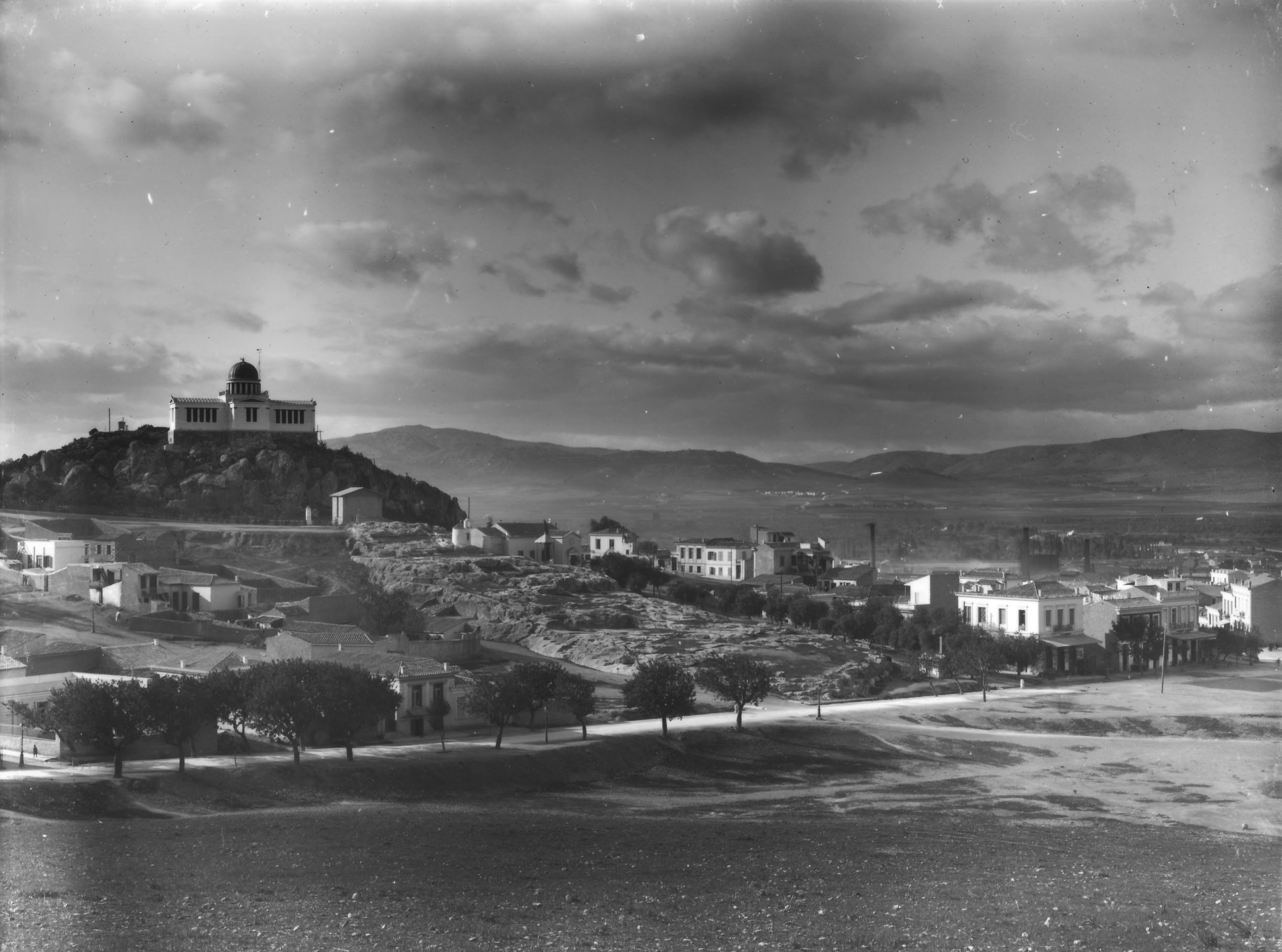 The Observatory and the cuttings of the Archaic shrine of Zeus, in the middle, along with the newly built structures before 1927, the year the contemporary Agia Marina was erected (Nicholson Museum, Professor W.J. Woodhouse Collection).